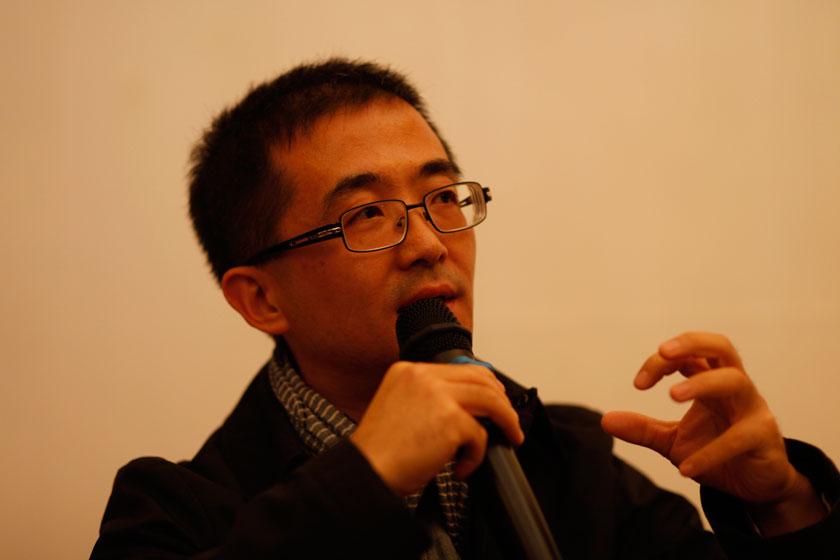 11月16日,大众点评联合创始人龙伟。   王攀/财新记者_电商:死而后生?