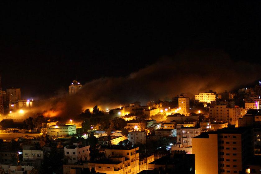以色列空袭加沙地带_以色列空袭加沙已致69人死亡_图片频道_财新网