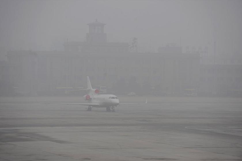 1月29日的雾霾天气给北京首都国际机场的航班正常运行