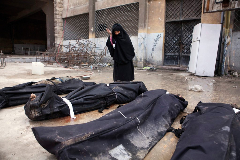 叙利亚死人图片_叙利亚阿勒颇一河道内发现35具平民尸体_图片频道_财新网