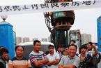 报告称农民工集体行动推动工会改革