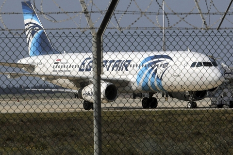 A hijacked Egypt Air A320 airbus stands on the runway at Larnaca Airport in Larnaca