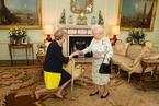 一周人物:特里莎任英首相 梁振英清理海岸垃圾