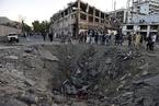阿富汗炸弹袭击致数百人伤亡 爆炸位置留下巨坑