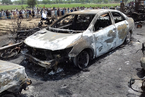 巴基斯坦一油罐车侧翻引发大火 致200多人死伤