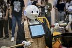 日本举行国际殡葬展会 机器人主持葬礼引围观