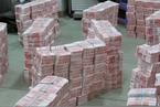 广东警方侦破特大假钞案 涉案面值2.14亿元
