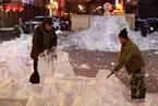 哈尔滨气温回升 中央大街部分冰景拆除