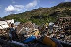 龙目岛地震建筑损毁严重 游客滞留机场等待撤离