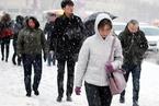 乌鲁木齐发布结冰黄色预警 市民踏冰雪出行