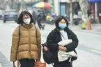 预防新型冠状病毒感染 杭州市民戴口罩出门
