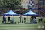 北京新冠疫情呈升级趋势 居民排队接受核酸筛查